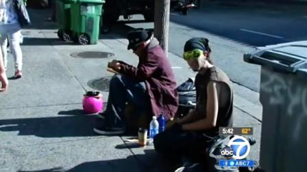 Two men are seen sitting on a sidewalk in Berkeley, Calif., in this undated file photo. Mayor Tom Bates  hopes to get an initiative on the November ballot that would ban people from sitting on city sidewalks during certain times of the day.