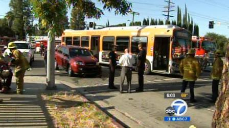 Authorities are seen at the site of an MTA bus crash in West Hills on Saturday, June 2, 2012.