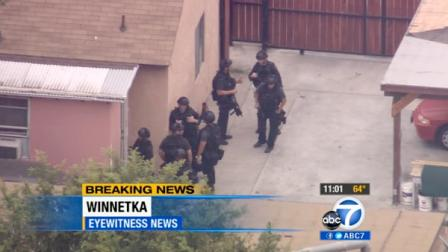 A SWAT team is seen surrounding the home of a barricade suspect in Winnetka Monday, June 4, 2012.