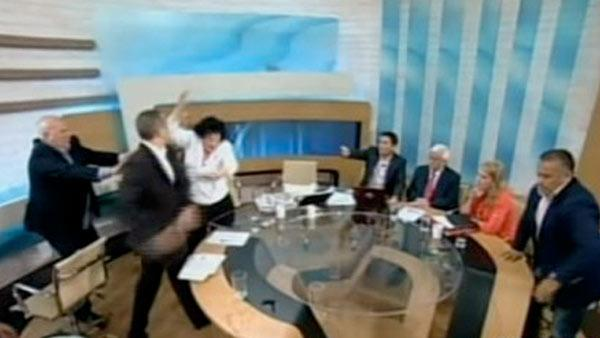 Greek extremist party member hits woman on TV
