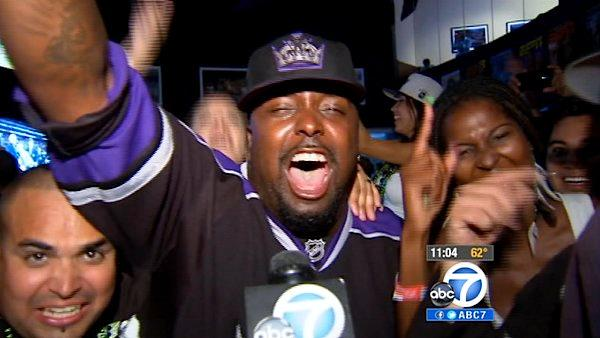 LA Kings fans are seen celebrating the team's Stanley Cup victory at a local bar Monday, June 11, 2012. The LA Kings won the Stanley Cup for the first time in franchise history with a 6-1 win over the Ne