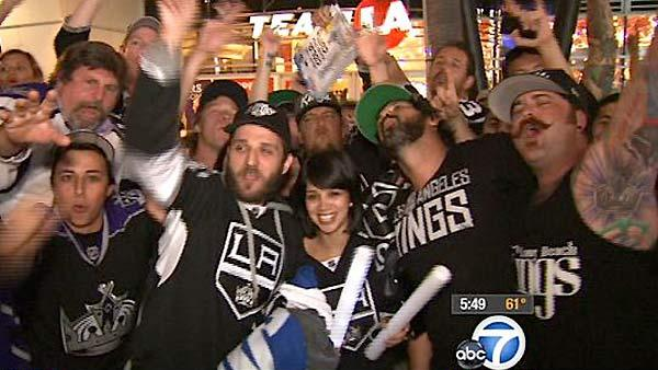 LA Kings fans are seen celebrating the team's Stanley Cup victory outside the Staples Center on Monday, June 11, 2012.