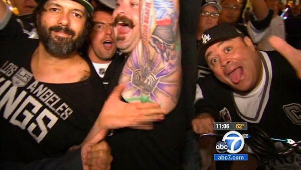 An LA Kings fan shows off the Kings tattoo on his armpit. The LA Kings won the Stanley Cup for the first time in franchise history with a 6-1 win over the New Jersey Devils on Monday night at Staples Center.