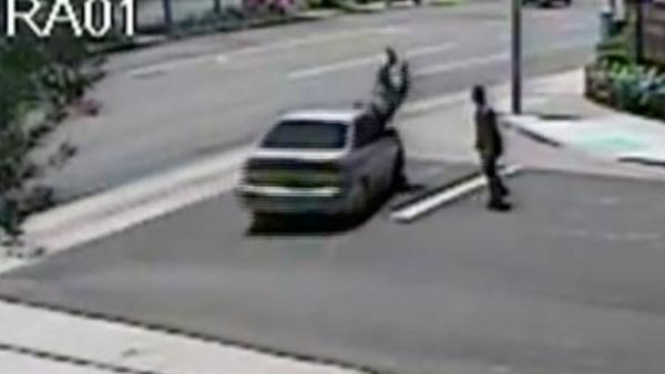 Caught on tape: Driver swerves to hit man