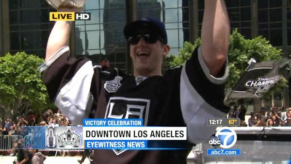Los Angeles Kings' Jonathan Quick hoists the Stanley Cup during a parade celebrating the team's NHL hockey Stanley Cup championship in Los Angeles, Thursday, June 14, 2012.