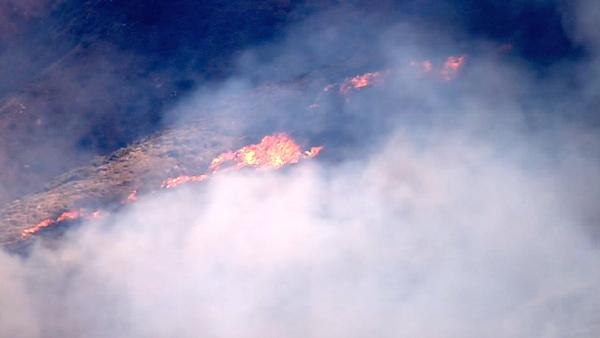 An aerial shot shows part of a major brush fire in Beaumont on Saturday,