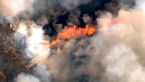 An aerial shot shows part of a major brush fire in Beaumont on Saturda