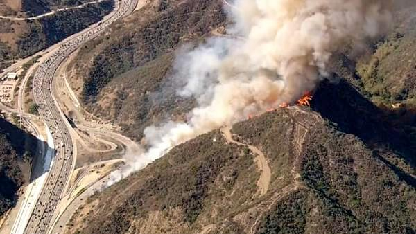 A brush fire is seen burning in the Sepulveda Pass near the 405 Freeway at Getty Center Drive on Friday, September 14, 2012.