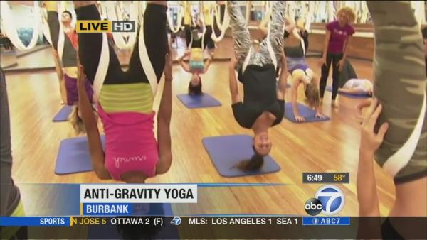 Anti-gravity yoga helps you stretch further