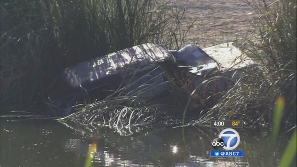 Jogger finds body in burned vehicle in Irvine