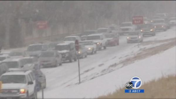Travelers wary as winter storm moves eastward