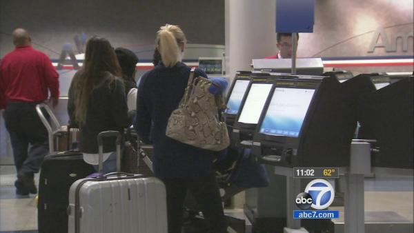 Travelers book earlier flights to avoid storm