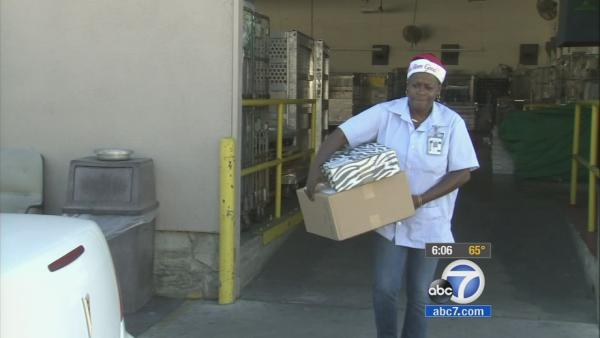 Postal workers deliver packages Christmas Day