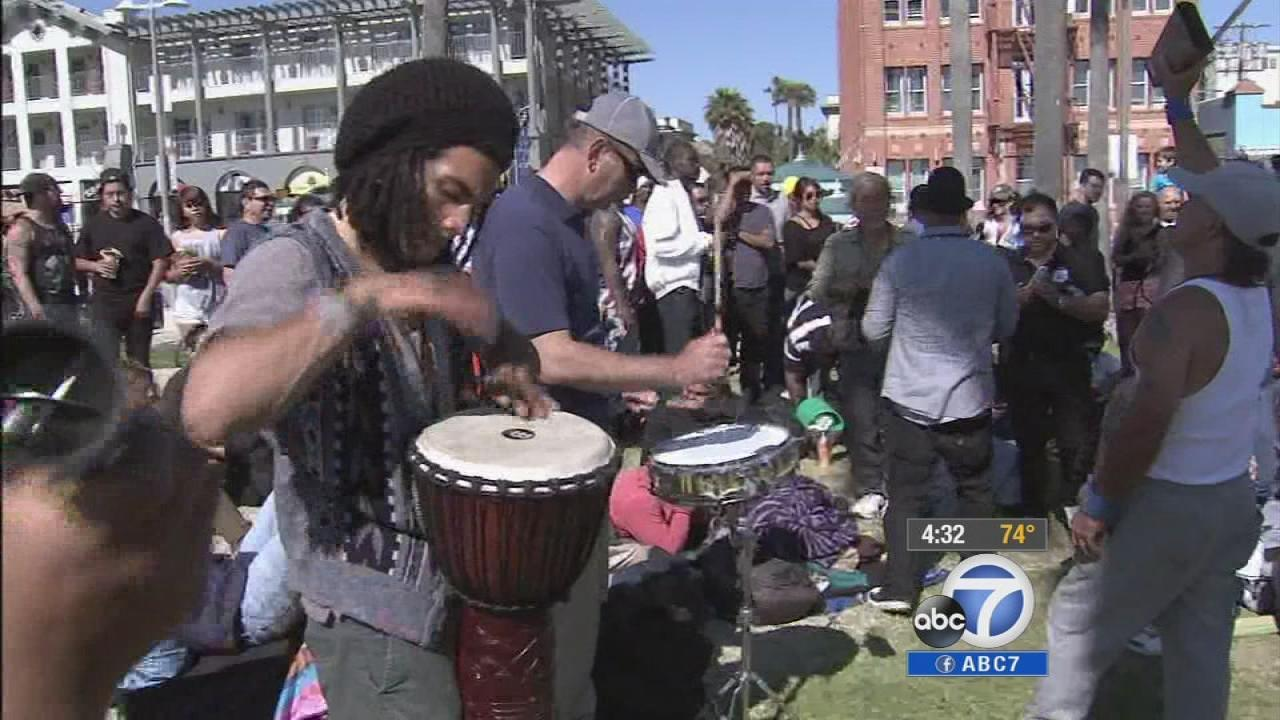 People are gathered at the weekly drum circle in Venice on Sunday, April 6, 2014.
