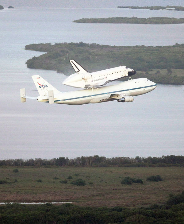 Space shuttle Endeavour makes its departure atop a modified jumbo jet from the Kennedy Space Center, Wednesday, Sept. 19, 2012, in Cape Canaveral, Fla. Endeavour will make a stop in Houston before heading to the California Science Center in Los Angeles.  <span class=meta>(John Raoux)</span>