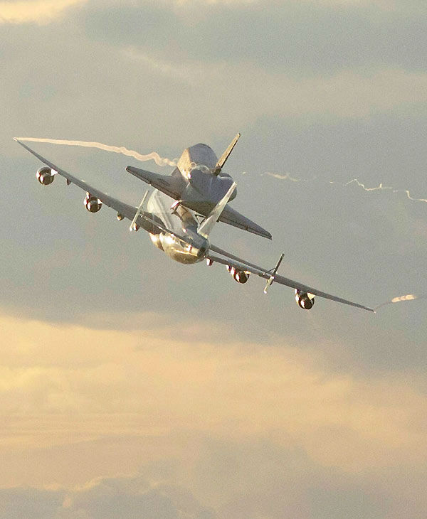 Space shuttle Endeavour atop a modified jumbo jet makes its departure from the Kennedy Space Center, Wednesday, Sept. 19, 2012, in Cape Canaveral, Fla. Endeavour will make a stop in Houston before heading to the California Science Center in Los Angeles. <span class=meta>(John Raoux)</span>