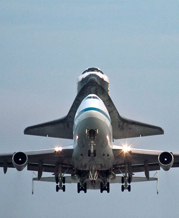 Space shuttle Endeavour atop a modified jumbo...