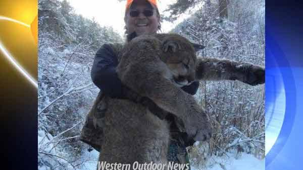 Fish/Game honcho shown with dead mountain lion