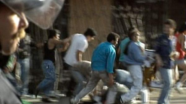 Looters are seen fleeing from businesses during the 1992 L.A. riots.