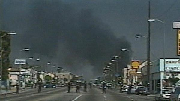 Smoke from multiple fires is seen near a Shell gas station during the 1992 L.A. riots.