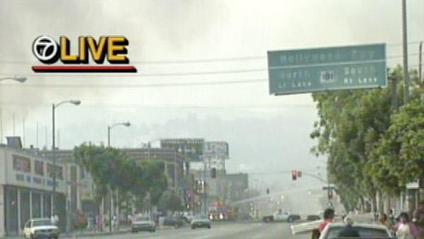 Smoke from multiple fires is seen near an entrance to the 101 Freeway during the 1992 L.A. riots.