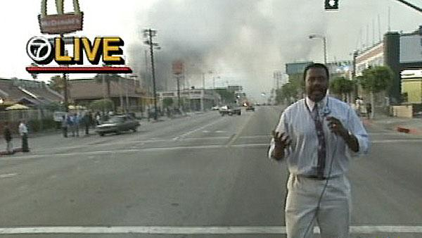 ABC7's Marc Brown is seen reporting live near the scene of a fire during the 1992 L.A. riots.