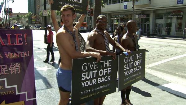 Scantily clad men push for donated clothes