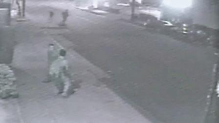 A still from surveillance footage shows a stabbing suspect (left) in a confrontation with one of two stabbing victims (right) in Echo Park.
