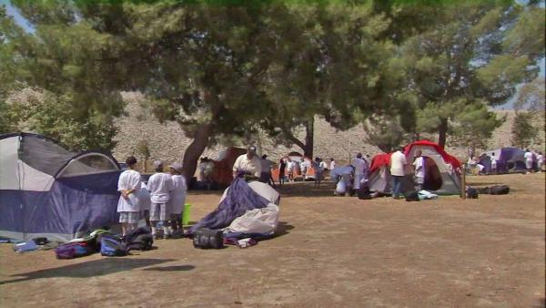 Disadvantaged city kids take camping trip