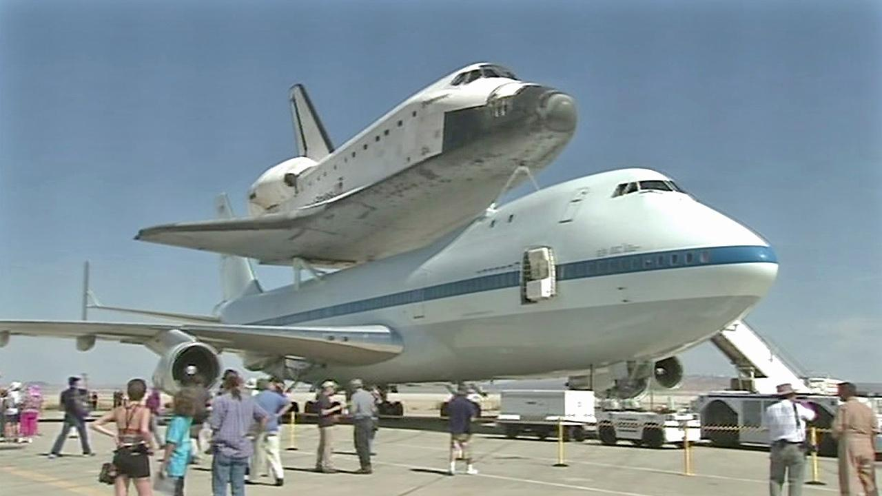 A crowd is seen catching a glimpse of the space shuttle Endeavour at Edwards Air Force base on Thursday, Sept. 20, 2012.