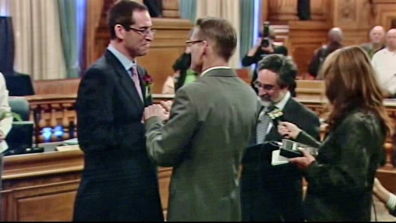 Two men are seen getting married in this undated file photo.
