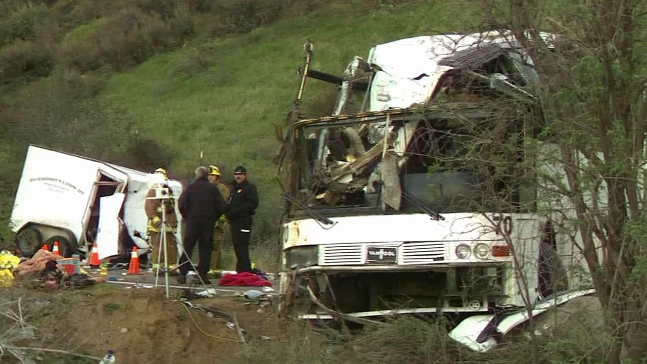 Investigators are seen combing through the wreckage of a tour bus crash on State Route 38 near Yucaipa that killed eight people and injured 38 others Sunday, Feb. 3, 2013.
