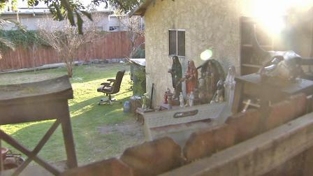 An altar in a Pasadena backyard where a human skull and other human bones were believed to be found is seen on Sunday, Feb. 17, 2013.