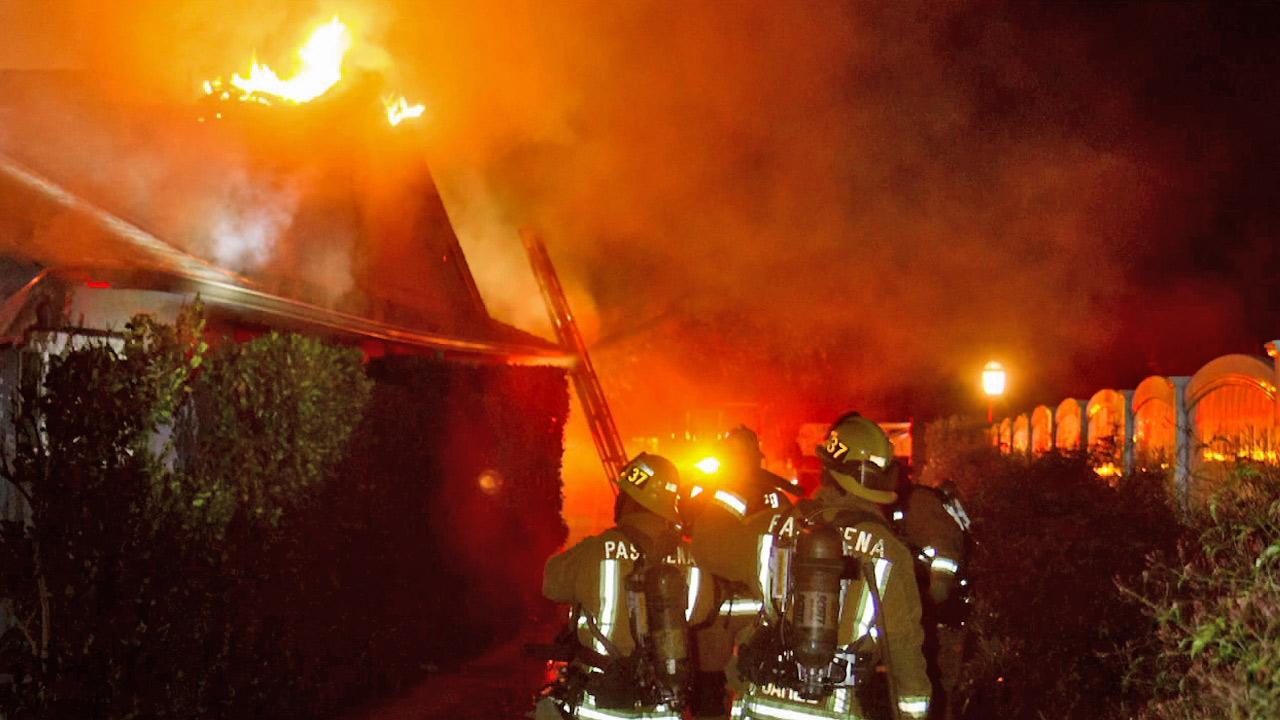 Firefighters are seen battling flames at a home in the 2000 block of Brigden Road in Pasadena on Saturday, Feb. 16, 2013.