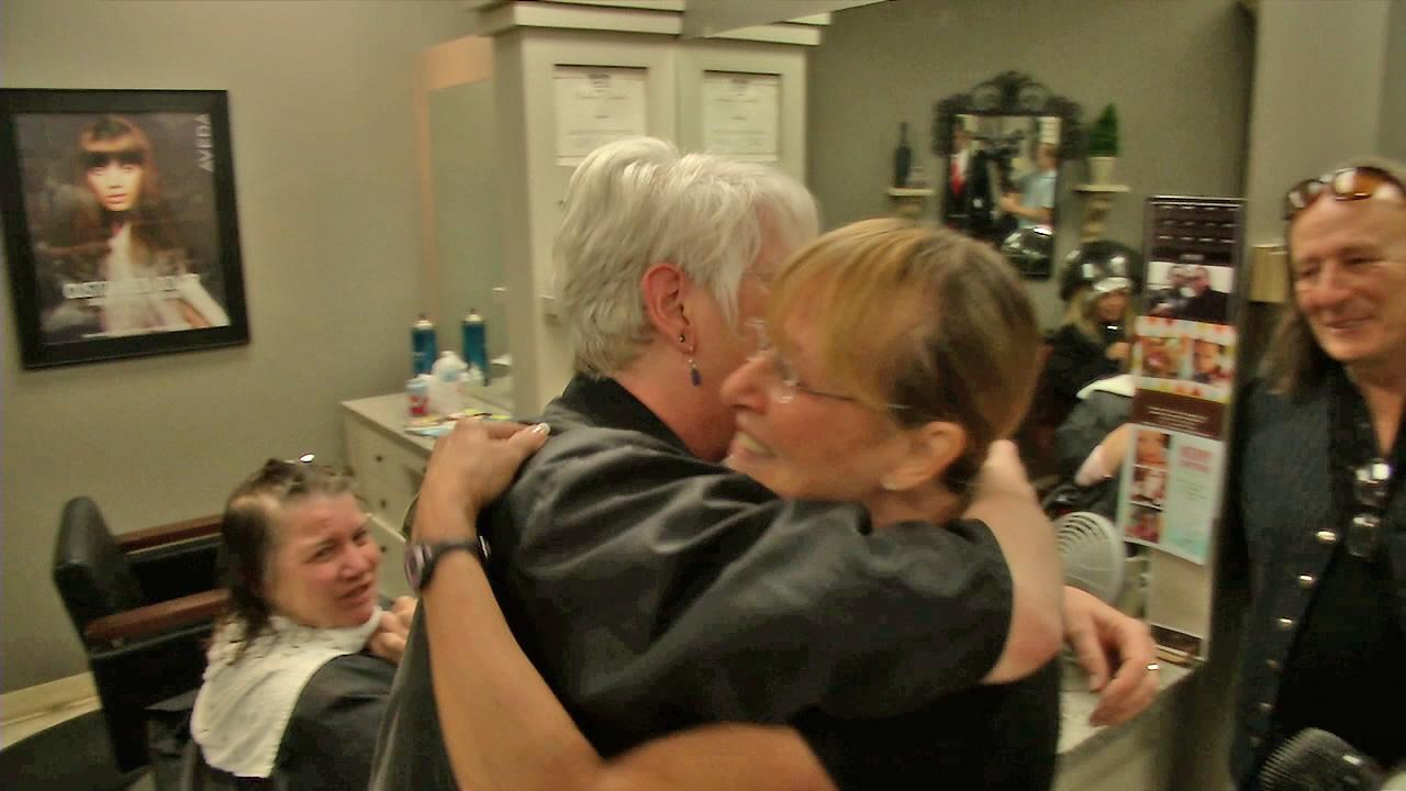 Mary Ridlen, left, hugs her neighbor Sali Jo Dowd, right0 after Dowd gave Ridlen $500 from ABC7s Pay It Forward.