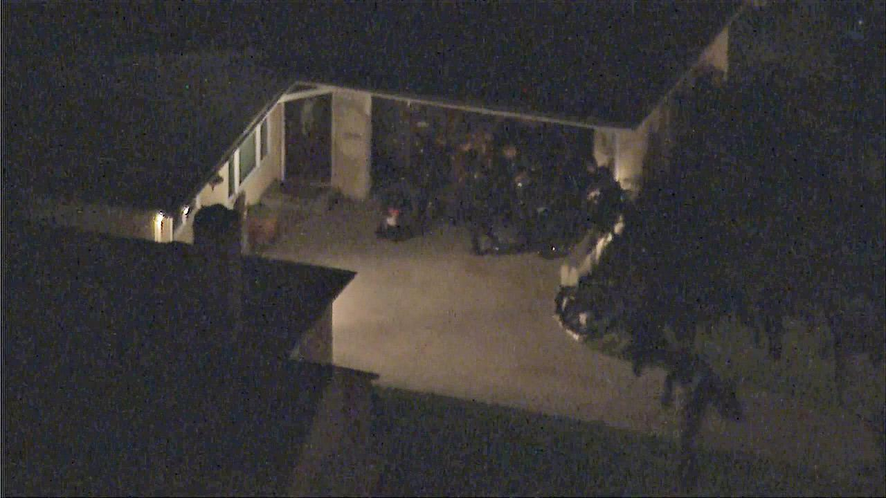 LAPD officers are seen at a home in Baldwin Village where a father was holding his 1-year-old baby in a standoff on Thursday, March 14, 2013.