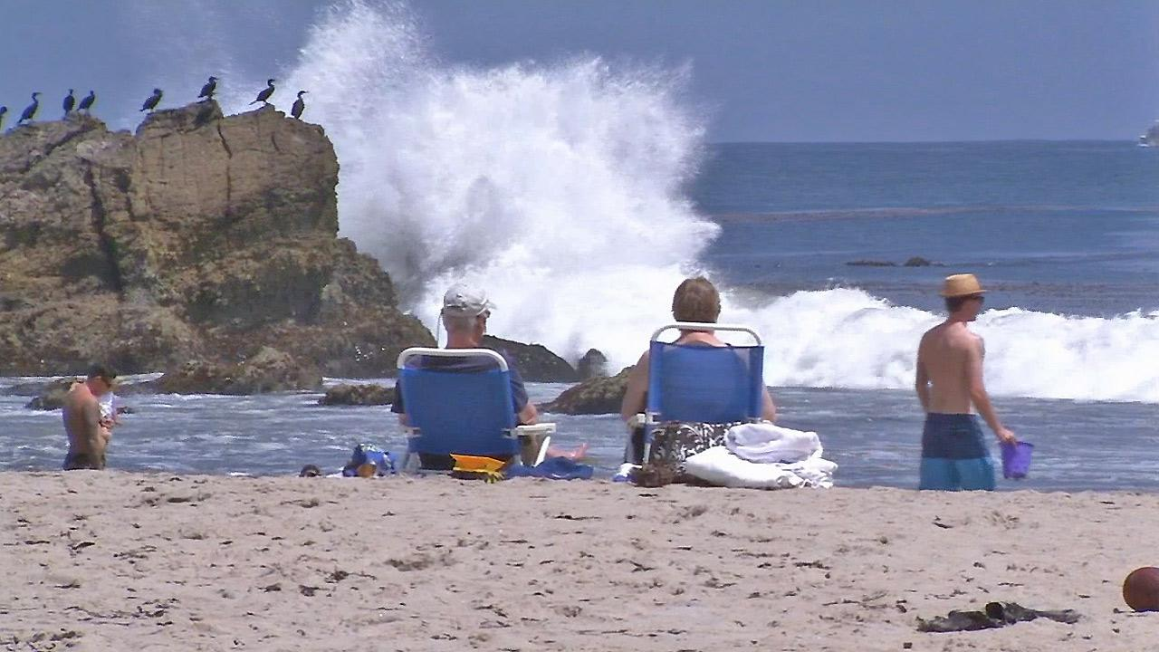 Visitors are seen at Leo Carrillo State Beach in Malibu on Friday, May 24, 2013.