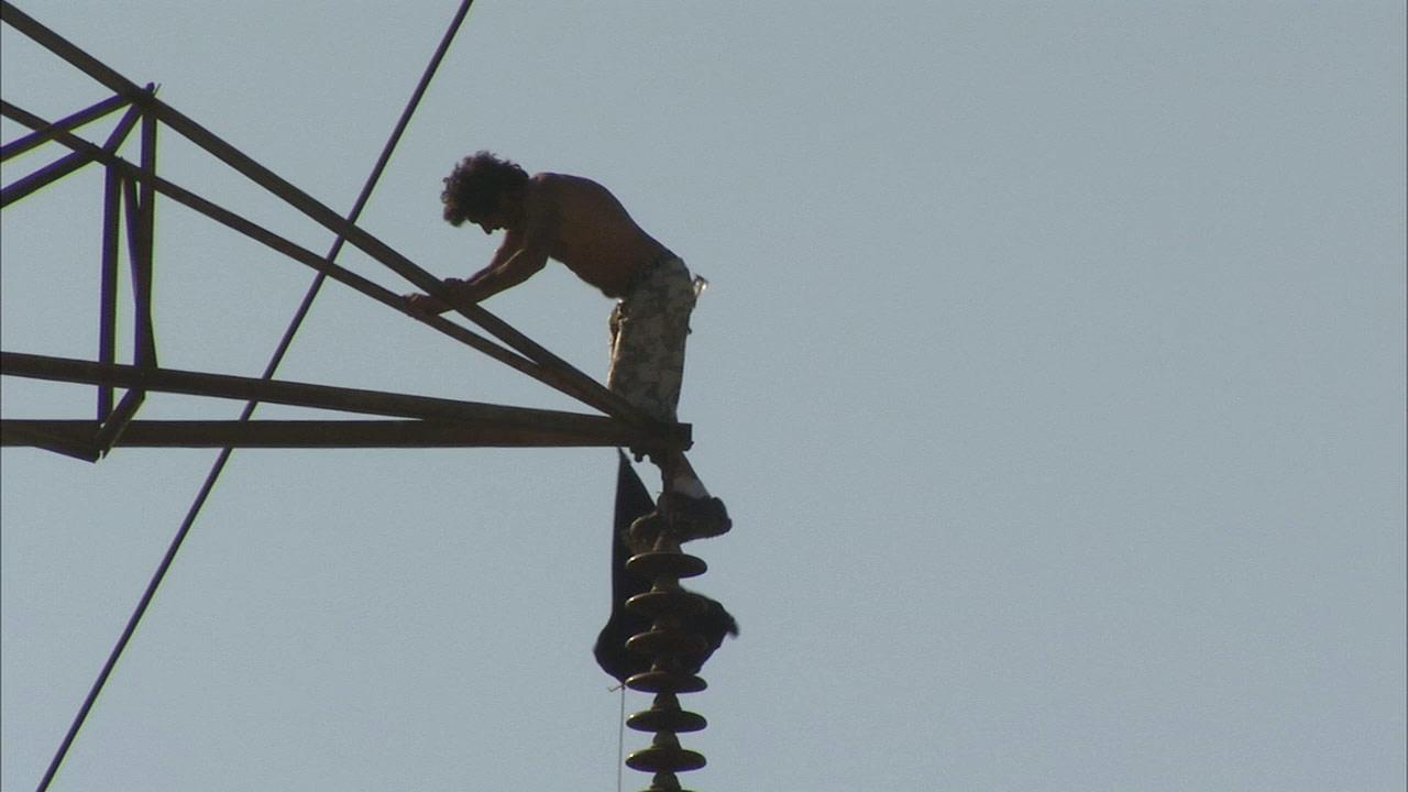 A man climbed hundreds of feet to the top of a high powered transmission tower in North Hollywood on Friday, June 14, 2013.