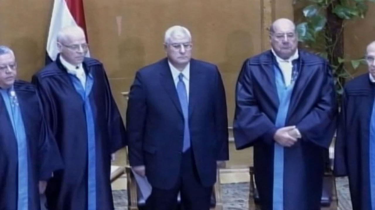 Egypts chief justice Adly Mansour prepares to swear in as the nations interim president Thursday, July 4, 2013.