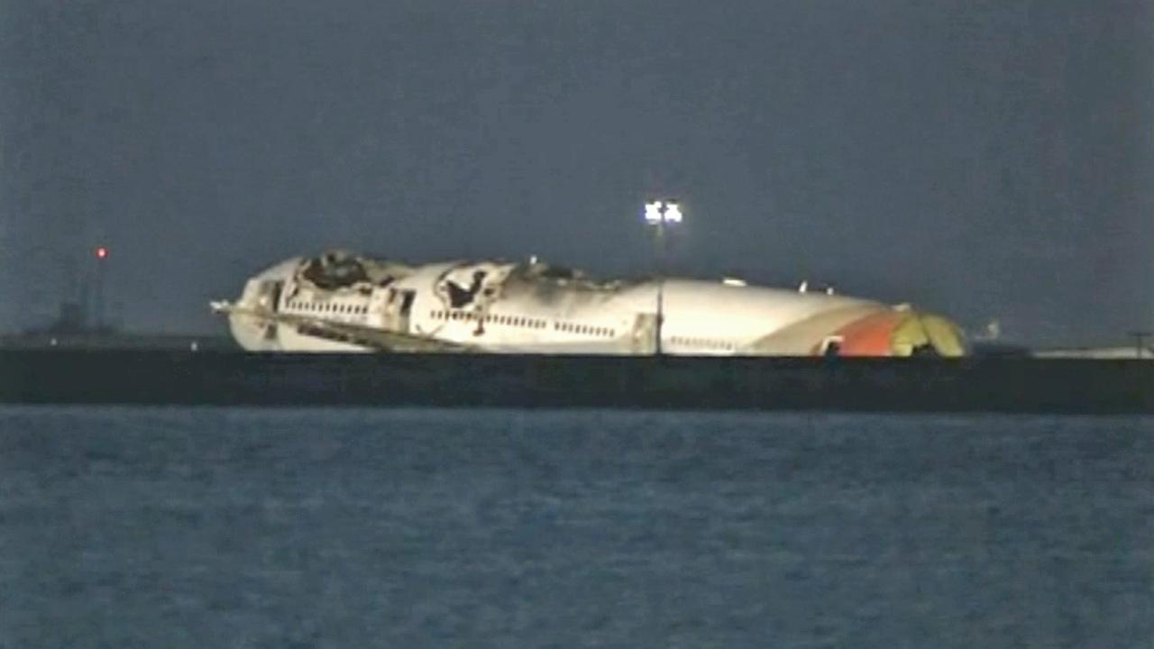 Wreckage is seen following a plane crash at SFO Saturday, July 6, 2013.