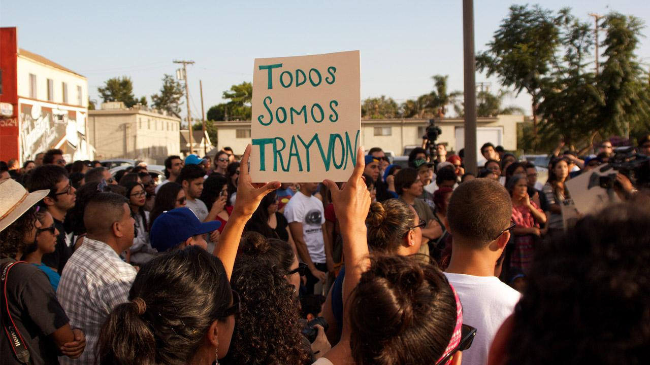 A girl holds a sign in Spanish that reads, Todos Somos Trayvon, or We are all Trayvon as people in the Boyle Heights neighborhood of Los Angeles protest the acquittal of George Zimmerman.