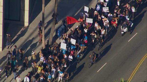 More than 100 marchers protesting the acquittal of George Zimmerman in the Trayvon Martin case took to the streets of Beverly Hills on Wednesday, July 17, 2013.