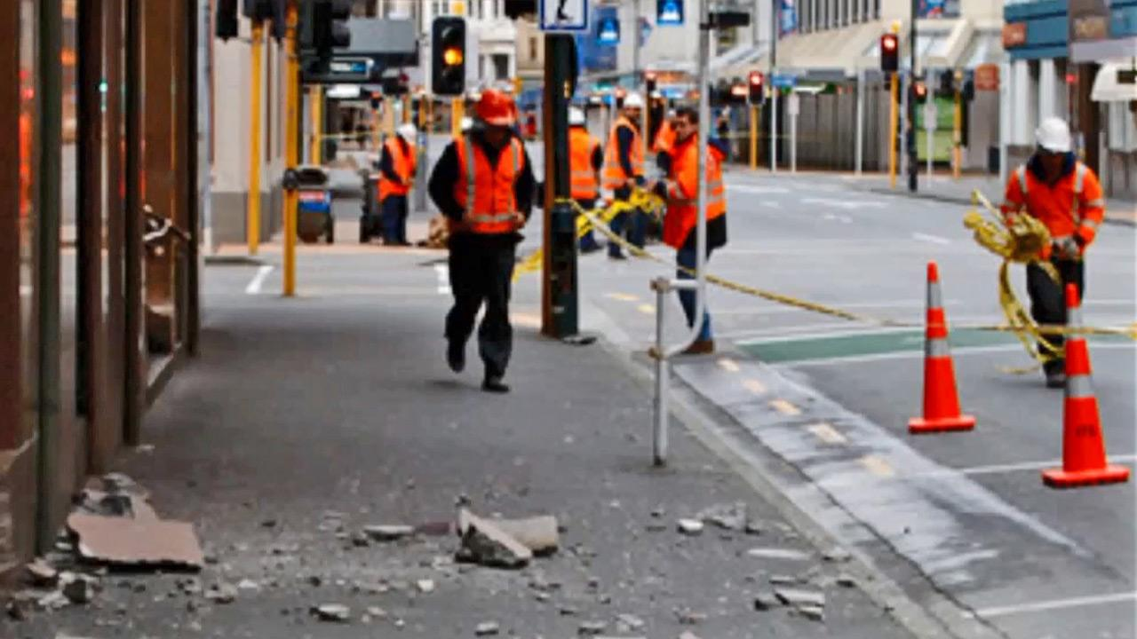 Workers are seen in the streets of New Zealand following a 6.8-magnitude earthquake Friday, Aug. 16, 2013.