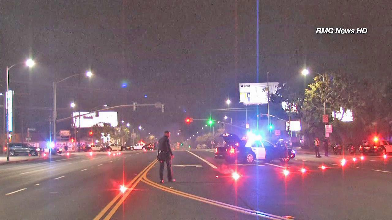 Police investigate a deadly hit-and-run in Venice on Friday, Sept. 20, 2013.