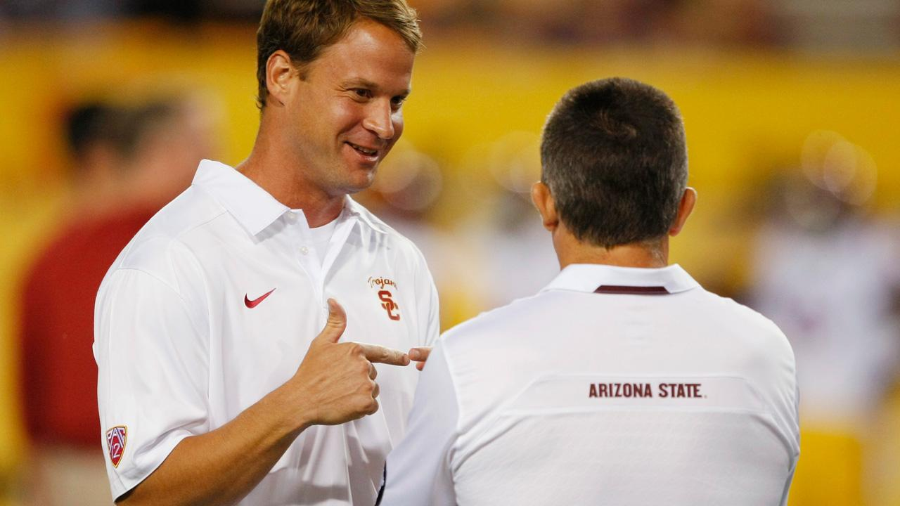 FILE - Southern California coach Lane Kiffin talks to Arizona State coach Todd Graham before an NCAA college football game in a Saturday, Sept. 28 2013, file photo, in Tempe, Ariz.