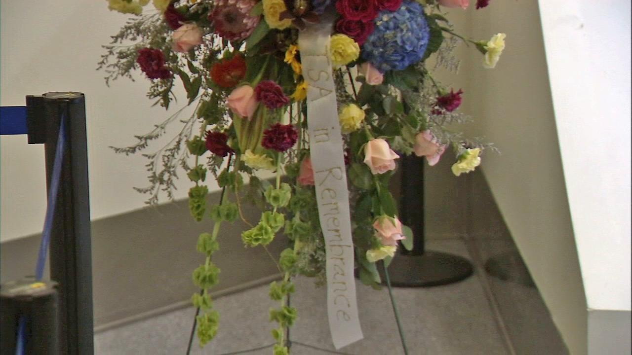 A wreath with a ribbon that reads TSA in Remembrance is seen on display in Terminal 3 at LAX on Sunday. Nov. 3, 2013. A TSA agent was shot and killed in the terminal in a shooting rampage two days before.