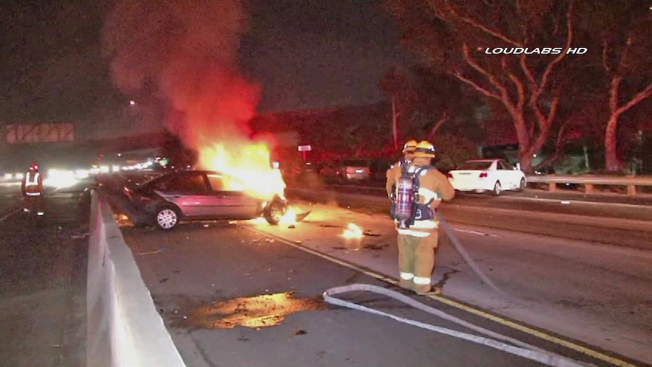 A car is seen in flames after a multi-car collision in West Los Angeles on Sunday, Nov. 10, 2013.