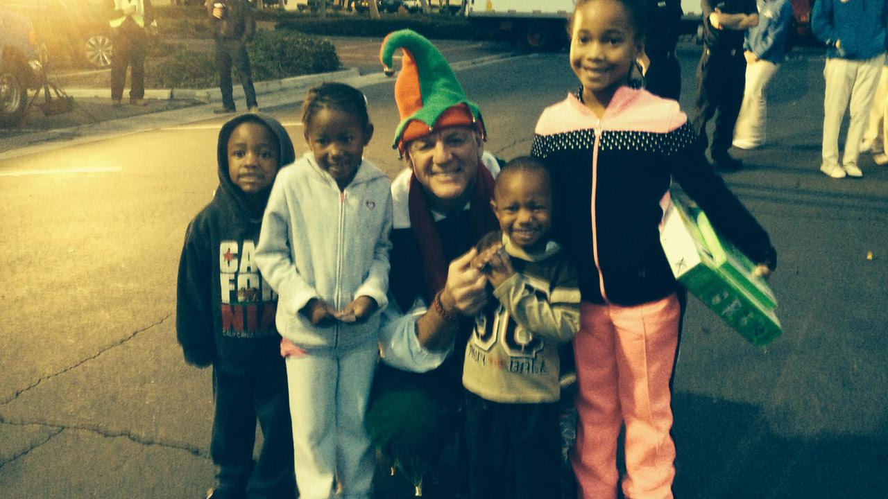 The Jones Family from Whittier visits Garth the Elf at Stuff-a-Bus in Cerritos on Friday, Nov. 22, 2013.