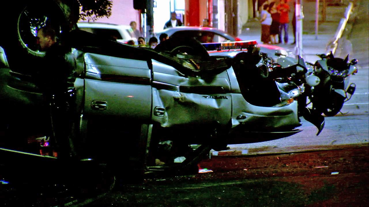 A car is seen after it rolled over in the Westlake district Thursday, Nov. 29, 2013. The driver was killed.