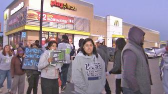 Workers protest for higher pay outside of a McDonalds in South Los Angeles on Thursday, Dec. 5, 2013.